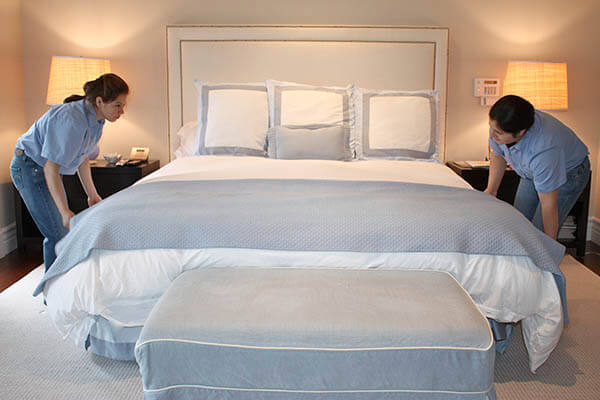 spotless cleaning services bedroom making bed